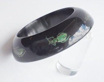 Funky black lucite bracelet with real exotic insects