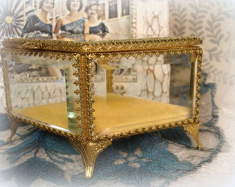 vintage gold and glass jewelry casket diamond shape hinged lid decorative feet THICK beveled glass sides and top STYLEBUILT frame co NY
