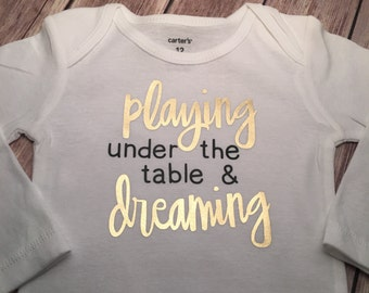 Playing Under the Table and Dreaming BodySuit