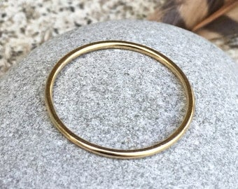 14k gold micro gossamer thin slim smooth plain delicate wedding band or dainty and minimal stacking ring by kimberly nogueira
