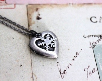 snowflake. heart locket necklace. in silver ox jewelry