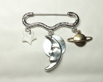 Midnight magic star moon planet silver tone brooch / pin