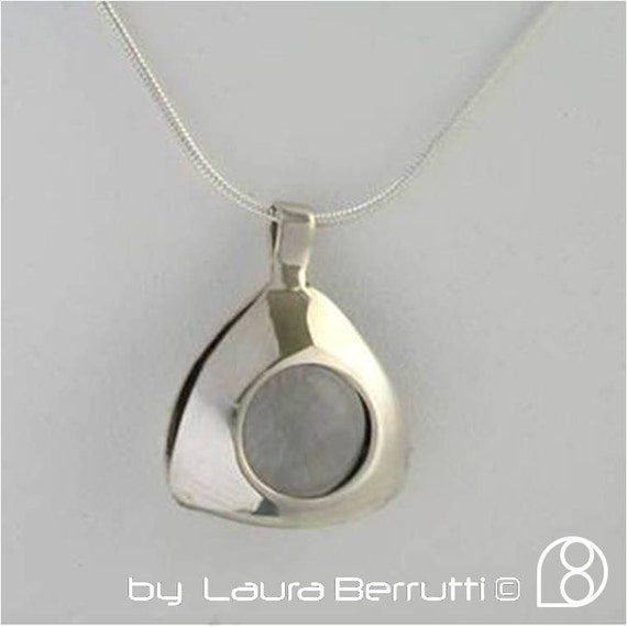 Sterling Silver Kinetic Pendant with Crystal sphere in tension