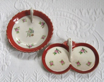 2 dishes with handles . orange rim dishes . little rose dishes