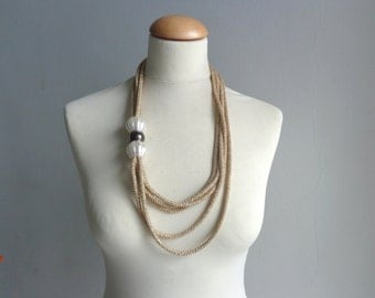 Gold pearls necklace in metallic  new, multi strand necklace