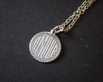 Silver tone amour necklace