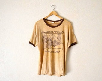 "80's ""Zimmer Slave Camp"" Paper-Thin Graphic T-Shirt"