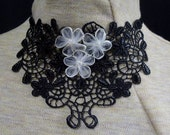 SALE:      black & white applique necklace with white flowers -