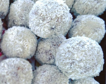 A bag of 2 Raw Vegan Rawphaello energy balls with sukkary caramel. Organic and no gluten or sugar