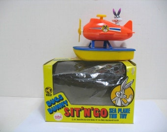 Vintage Bugs Bunny Sit N Go Sea Plane Bathtub Wind up Toy NMIB Bugs Bunny Airplane in Box