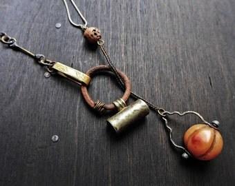 Hierology. Carnelian melon ball and prayer vessel lariat necklace.