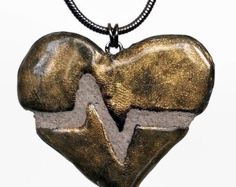 Gold Heart Necklace : Beating Heart Pendant in Black Silver and Brass