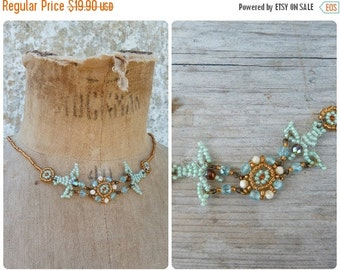 ON SALE Turquoise doves  Handmade in France seed beads / beaded/beadwork necklace