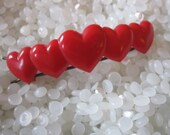 vintage barrette , bright red shell hearts in a row