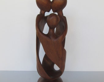 Modern Man Woman and Child Wood Sculpture