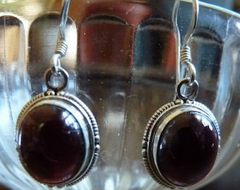 Two styles of garnet drop earrings