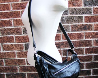 Black leather messenger sling bag with short strap to convert to shoulder purse with Pleated bottom and tassel