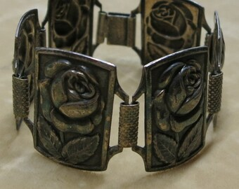 A Panel Bracelet of Repousse Roses