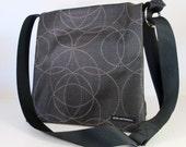 """MESSENGER BAG in vinyl """"Circles"""". Cross Body Bag. Travel Bag. Diaper Bag. Fabric Bag. waterproof bag. Made in USA."""