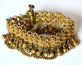 Vintage antiqued brass Kuchi style cuff bracelet with baubles