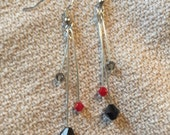 Black, lipstick red, and gray, tiered Swarovski crystal earrings