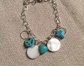 Beaded, charm, shell, peace, love, and cross chunky bracelet