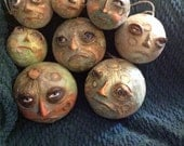 Man in the moon face ornaments