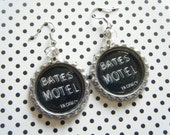 Bates motel sign bottle cap earrings with clear faceted glass beads