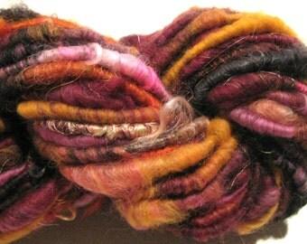 Handspun yarn Sahara Nights 45 yards  art yarn gold burgundy black pink corespun yarn knitting supplies crochet supplies Waldorf doll hair