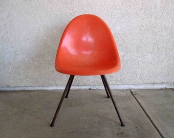 Vintage Mid Century Fiberglass Shell Chair in Orange. Circa 1950's.
