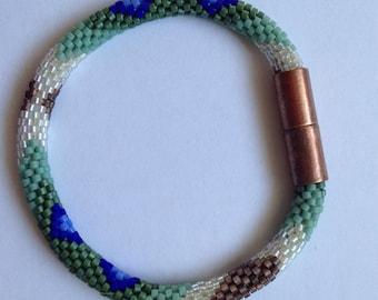 copper, blue and green bracelet
