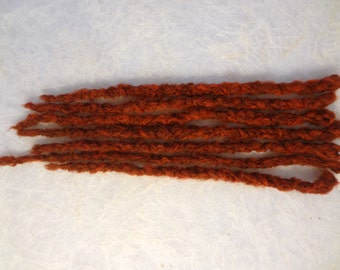 7 Textured Tomatoe Red Synthetic Dreadlock Extensions. Short length 12 inches. Interesting unique textured dreads. Hair Extensions.