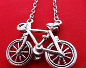 """20% off sale Vintage 20"""" silver tone necklace with attached 1.5"""" bicycle pendant in great condition"""