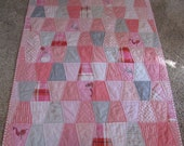 Patchwork tumbler quilt using the Sarah Jane fabric out to sea for baby/toddler girl