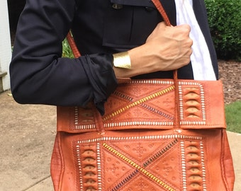 Vintage brown leather tooled woven and embossed bag