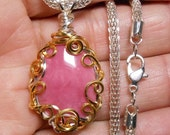 Rhodonite, deep pink color,  single sided drop cabochon pendant, hand wrapped silver and gold  filigree setting