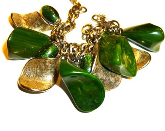 Gorgeous Green Bakelite Bauble Bracelet. Vintage Swirled Bakelite Nugget Dangle Charms. Seven Inches Long Gold Tone Metal Bracelet. 1950s.