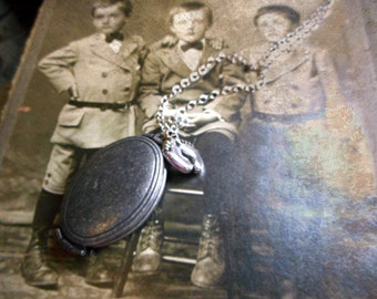 The Little Ones. Antique 4 photo holder Pewter locket , little feet charm & silver plated necklace. Ooak.
