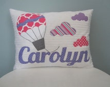 A Quatrefoil Personalized Hot Air Balloon with Colorful Clouds Pillow