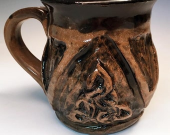 Carved Stoneware Mug with Celtic Knot