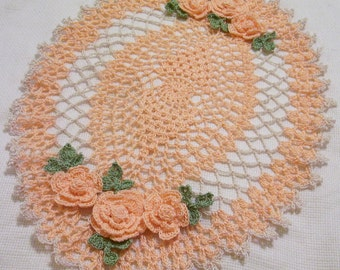 peach and ecru oval crocheted doily