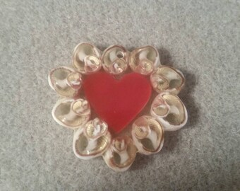 Red heart in sea shells !