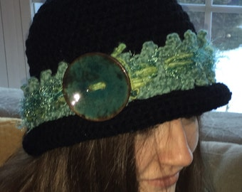 Black Crocheted Hat with A Brim and A Fancy Band with a Large Ceramic Button...Teal and Green