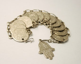 Vintage coin bracelet. Faux coins. Silver coins.  Hand of Hamsa.  Hand of Fatima