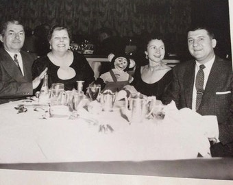 Vintage 1950s Photo Picture Of 2 Ladies & 2 Men With A Rubber Face Monkey In The Middle Conrad Hilton Chicago Illinois