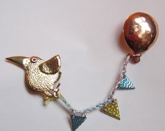 bird with balloon and bunting brooch