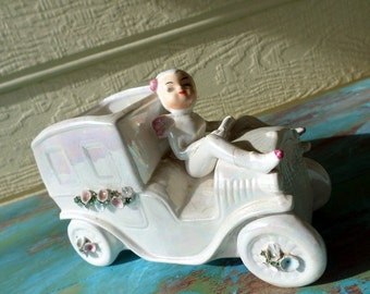 "Pixie Elf vintage Planter Car or Truck with Pixie Driver White Luster with Flower Details 2362 measures 7 1/4"" long 5"" tall 3 1/2"" wide"