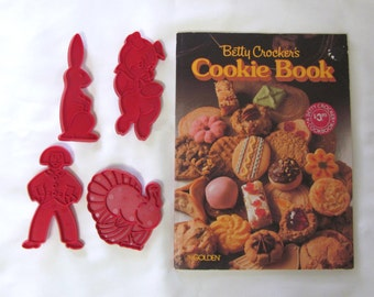 Four Vintage Red Plastic Cookie Cutters and Betty Crocker's Cookie Recipe Book Cookbook