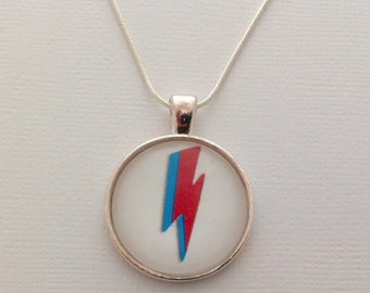Tribute to David Bowie: Ziggy Stardust / Aladin Sane lightning under a glass dome- 25mm (1in)