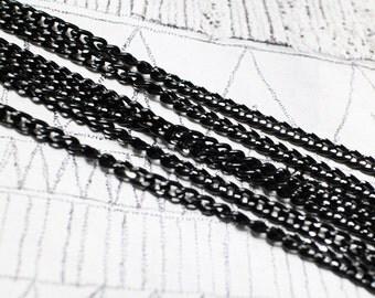 big shiny black Al chain